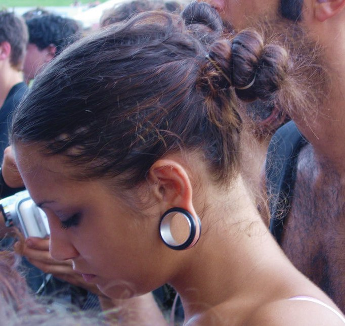 Young_woman_with_stretched_ear_piercing